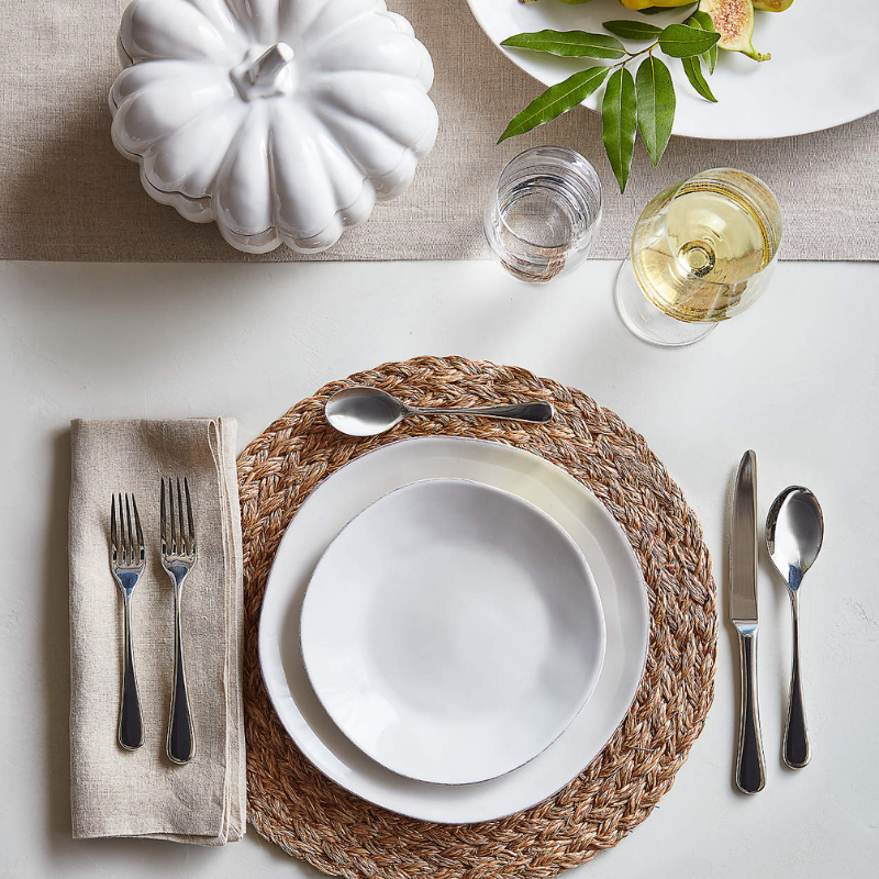 White & neutral toned table setting with linen napkins from Crate & Barrel
